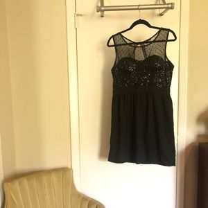 Cocktail dress with sequins and neckline detail
